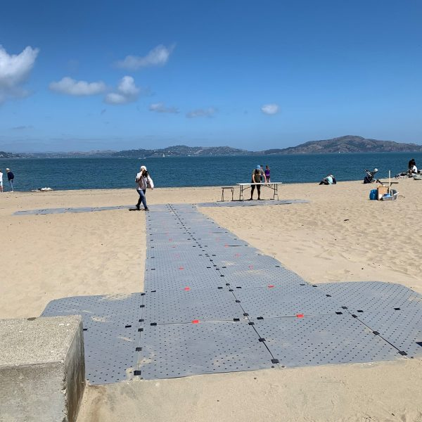 Grey Beach Trax installed as a semi-permanent pathway at a beach in San Francisco.