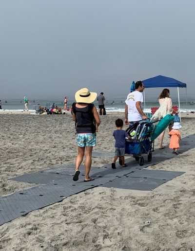 All sizes, all wheels move swiftly atop a Beach Trax pathway.