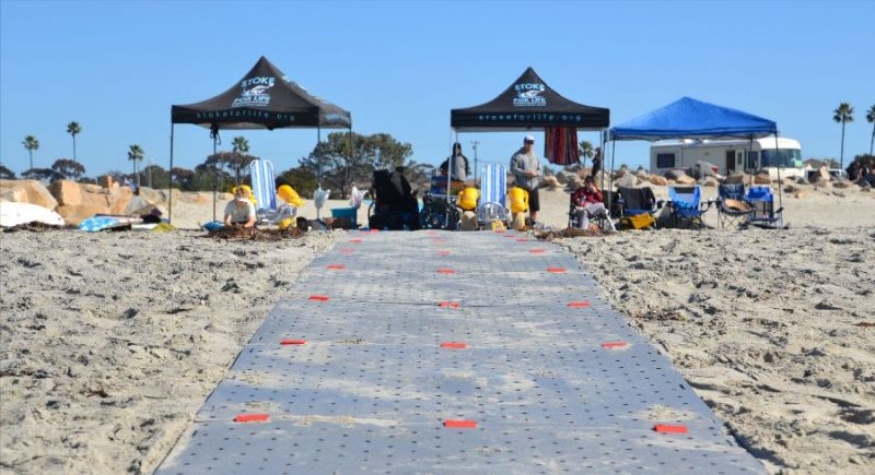 Beach Trax in Oceanside Beach. Tents and shoreline is in distance.